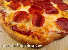 The Best Pizza Sauce    *Makes enough for 2 16-18 inch pizzas    1 (14.5 ounce) can diced tomatoes (petite better)  1 small can tomato paste  1 teaspoon sugar  1 teaspoon dried oregano  1 teaspoon dried basil  1 teaspoon garlic salt  pinch of red pepper flakes (optional)