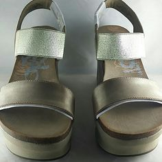 """OTBT Women's Bushnell Wedge Sandal Color is New Gold size 7 1/2 - Leather/ Textile - Imported - Synthetic sole - Heel measures approximately 3.5"""" - Platform measures approximately 1.75"""" - Comfortable foot bed - Elastic strap for snug fit  - OTBT combines lux leather with cork to craft the Bushnell  Wedge sandal  -   - OTBT  Shoes Sandals"""