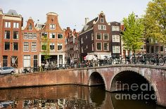 Bridge and historic houses on Keizersgracht canal in the city of Amsterdam, Holland.