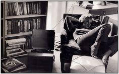 Marilyn Monroe relaxes with her record player.