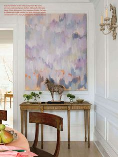 abstract art with feminine antiques and modern, glamorous lighting = perfection