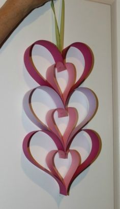 This easy to make paper heart decoration is easy enough for child to make. It's a nice Valentine's Day or Mother's Day project. This is a guide about making a Paper Heart Door Hanger. Valentine's Day Crafts For Kids, Valentine Crafts For Kids, Mothers Day Crafts, Valentines Day Decorations, Valentines Diy, Holiday Crafts, Diy Christmas, Heart Decorations, Paper Hearts
