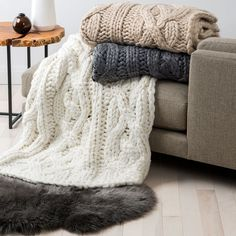 """A chunky cable design lends rustic, cabin-in-the-woods attitude to this cozy throw from Ugg. 