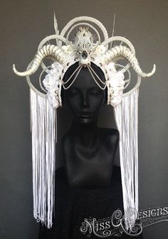 MissGDesignsShop Hand-made Ice Queen headdress. With faux feathers and faux horns. Accented with a spike studded skull and silk flowers. Your custom piece Feather Headdress, Mermaid Headpiece, Feather Jewelry, Circlet, Tribal Fusion, Headgear, Costume Design, Wearable Art, Fascinator
