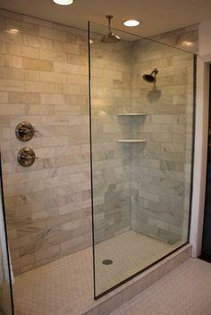Marble Subway Tile, Doorless walk-in, double shower heads, hexagon floor tile