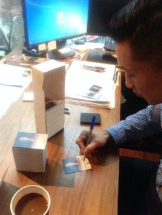 Terry Chen signing Continuum trading cards (via @theterrychen on Twitter)