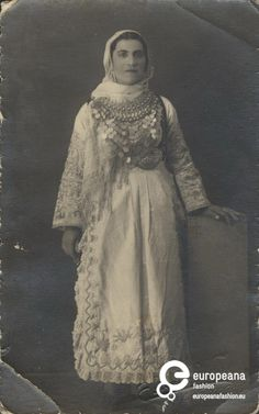 Woman with local costume from Avlonas Attica. Owner of the photo is the Peloponnesian Folklore Foundation.