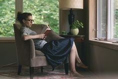 That's what I want to look like and be like. Cute clothes, comfy chair and a good book.