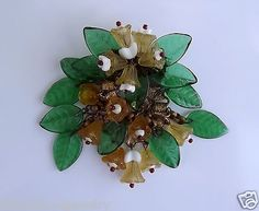 Another WWII era unsigned Haskell pin of hand-wired glass beads of green glass leaves, light golden yellow glass flowers, and white milk glass beds.