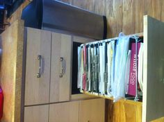 My boss installed a file cabinet draw in her kitchen for loose recipes. Great Idea!!