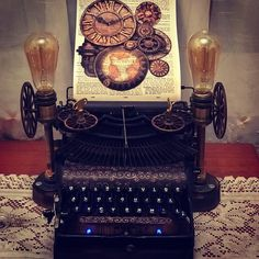Empire typewriter, restored to work and added brass wheels and a thick wooden base with blue lights, both lamps on each side are also installed on the wooden base. Typewriter, Restoration, Steampunk, Empire, Light Blue, Wheels, Brass, Lights, Typewriters