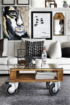 Impressive art wall collection and a favorite wheel coffee table via Sköna Hem blogg