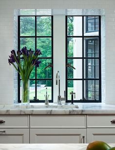 Black windows, white marble, white cabinets. Ooooh, yeah.