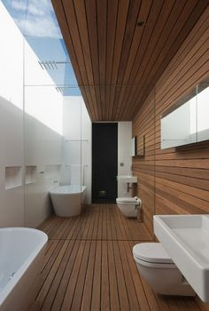 Bathroom with sky light and mirrored wall- great way to open up a small space.