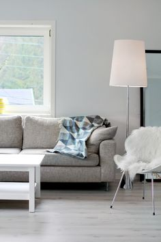 gray couch, white table