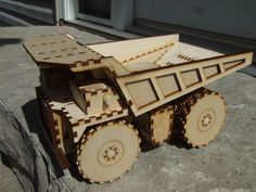"""With a young child enamored with vehicles of all types, I have previously built a laser cut front end loader and now have added to that a laser cut mining dump truck detailed here. Laser cut from 1/8"""" baltic birch with a few dowels for axles and pivots and held together with wood glue the result is pretty sturdy. The assembly measures about 9 inches long, 5.5 inches wide and 5 inches tall, has rolling wheels and pivoting dump bed. The dump truck is ..."""