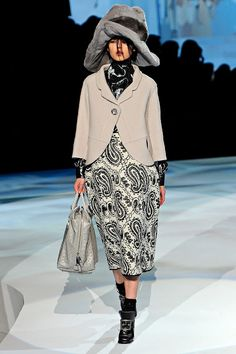 FW12 - Kolfinna: Cashmere Baby Blanket Jacket; Lamé Blouse; Wool Brocade Skirt; Lurex Argyle Sock; Metallic Shoe; Ostrich Bag; Mink Hat