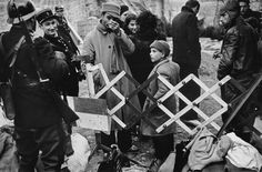 Robert Capa - Spain. January 25-27th, 1939. The French border, north of Barcelona. After the fall of Barcelona, but also fascist rule over all of Spain clearly imminent, about 500 000 Spanish civilians sought refuge and political asylum in France. France set up camps along the borders in the Pyrenees Orientales region.