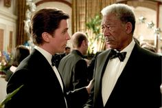 """Batman Begins"" movie still, 2005.  L to R: Christian Bale, Morgan Freeman."
