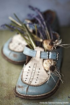 Flowers in shoes! I once did an awesome arrangement in a Victorian lace up boot.  Wish I didn't give that one away!