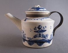 "Child's pearlware teapot, c.1790. With cobalt blue underglazed ""Chinese House"" decoration, derived from English Chinoiserie pieces rather than actual Chinese ornamentation."