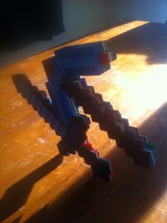 My brother Adam made a Lego diamond pickaxe and a Lego diamond sword. Mind blowing that u can do that with Legos. He loves I mean loves Legos. He has a shift in his room just for Legos. He has a very awesome imagination. :)