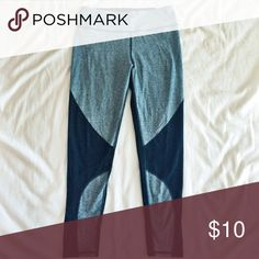 American Eagle leggings These super cute American Eagle leggings were never worn before. They are gray, black, and have a small sheer panel at the bottom that wraps around the ankle. American Eagle Outfitters Pants Leggings