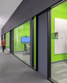 PagerDuty Office Conference Room Interiors | The green walls in the room really make the room pop!