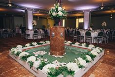 Amazing fountain...urn of hydrangeas and stock....white hydrangeas surrounding...petals and floating candles Blush Custom Weddings