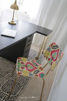 Mod Podge a graphic fabric onto a simple wooden chair: | 31 Gorgeous Furniture Upgrades That Only Look Expensive