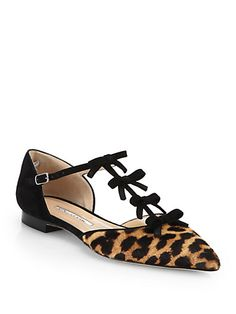 Oscar de la Renta flats l leopard  bows... I saw these in Vegas!... even took a pic of them lol.. only $725... hmmmm only.
