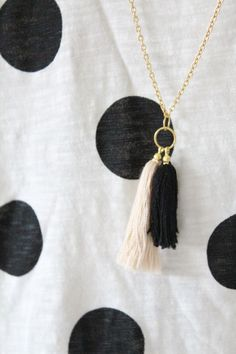 DIY tassel necklace by sugar and cloth. I'm imagining one could do different pedants on jump rings and then have a lobster clasp on the chain to change between the pedants!!
