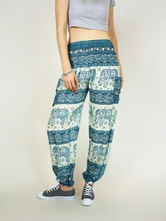 Teal and white elephant print bohemian harem pants from Thailand with 2 Pockets, elastic waist and leg holes. A portion donated to help prevent elephant poaching.