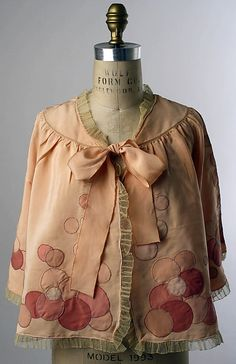 Bed Jacket via MET archive 1939-59 american or european  I LOVE the whimsy of the circle appliques abstract dots and big bow!