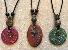 Polymer clay necklaces.  Sculpey, Fimo, Premo. Leather, acrylic paint, and beads.