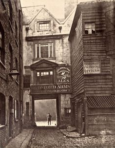The Ghosts of Old London. At the entrance to the Oxford Arms – the Society for Photographing the Relics of Old London was set up to save the Oxford Arms, yet it failed in the endeavour, preserving only this photographic record. Victorian London, Vintage London, Old London, Victorian Street, Victorian Era, London Pubs, Oxford London, London 1800, Victorian Photos