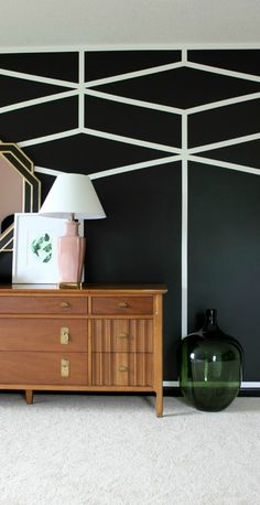 Check out the bold geometric accent wall in this DIY bedroom makeover from Jenna @rainonatinroof. Jenna created this modern black and white design to add interest to her pale pink walls. Chrome accents add an extra touch of glamour to this edgy bedroom. Read the rest of this post to see how Jenna designed the rest of her bedroom.