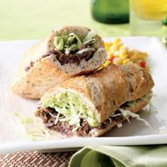 Tijuana Torta, with black or pinto beans, salsa, pickled jalapeño, onion, avocado, and green cabbage as the filling.