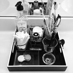 Leave things you use daily out on a pretty tray with glass dishes to organize