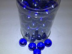 Amazon.com: TBC Decorative Marbles: Cobalt Blue 100% Glass Marbles. Vase Fillers Use in Floaral Arrangements, with Candles, Aquariums, Wet or Dry. Great for an Eye Catching Centerpiece. Can Also Be Used in Games. Aprox 75 Marbles Per Container. (Silver Added to Blue During Mfg to Create Deep Colbalt Blue Color): Home & Kitchen