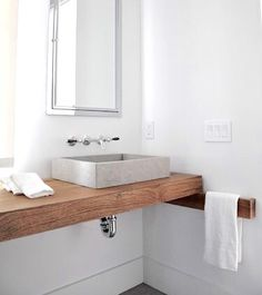 Wood vanity & towel bar with grey stone sink