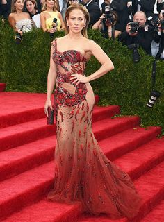 Jennifer Lopez bared her booty in a sexy, skintight Versace gown at the Met Gala 2015 on Monday, May 4, in New York City.
