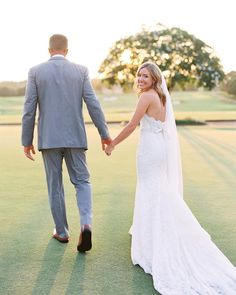 Swooning at the sight of our Taylor walking into the sunset with her hubby in 😍 Photography: Bridal Shop: Wedding Dress Train, Wedding Dress Styles, Here Comes The Bride, Chic Wedding, Fit And Flare, Lace Skirt, Brides, Walking, Gowns