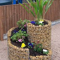 Herb Spiral garden design is perfectly productive and energy efficient. It lets you pile plants and maximize limited spaces.If you have limited space or sun