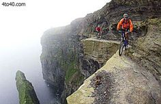 """This is some of the most insane mountain biking on the planet, The Cliffs of Moher in Ireland. It may look familiar to you as """"The Cliffs of Insanity"""" from the film, The Princess Bride. The updrafts can be strong … Continue reading → Cross Country, Mountain Biking, Cycling For Beginners, Cliffs Of Moher, Bike Path, Adventure Photography, Crazy People, Amazing Adventures, Extreme Sports"""