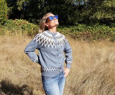 Norwegian Wool Cardigan Sweater. Made of 100% soft and silky new wool, this cardigan has the most amazing pattern and colors. Traditional style cardigan with folk pattern and shiny silver buttons with floral designs down the front. The blue is a cornflower blue, with dark blue and cream design. The wool is a heavy knot wool and very soft. It is the perfect sweater for wearing with jeans or pulling over something a bit fancier. It is comfy and warm and will keep you cozy all winter long! It…