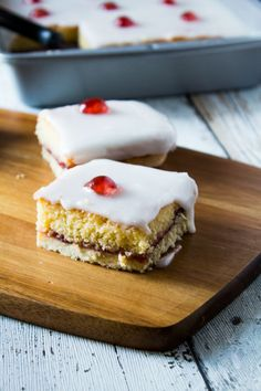 Take the classic Bakewell tart recipe and make it into a tray bake! A golden layer of shortcrust pastry filled with an almond cake, raspberry jam, and topped with icing and glacé cherries!
