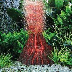 "H2ShOw Kits provide your aquarium with impressive centerpieces that combine a highly detailed ornament with powerful 2W LED lighting and abundant bubbling. The red lighting enhances the fine flow of bubbles to give your aquarium a unique and attractive glow. Ideal for aquariums up to 14"" deep. Both the LED lamp and bubble maker are included with the volcano."