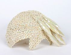 ~Bes-Ben pearl button hat   Covered by buttons with a pearl sheen. Six shell-like forms extend from left of hat   United States, 1950's~