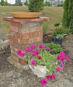 ROBINS NESTING PLACE: Birdbaths made from leftover bricks